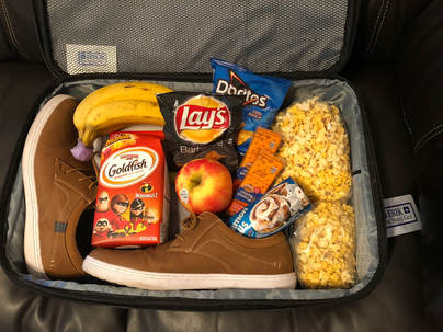 Erik The Travel Guy Snacks in Carry On Picture